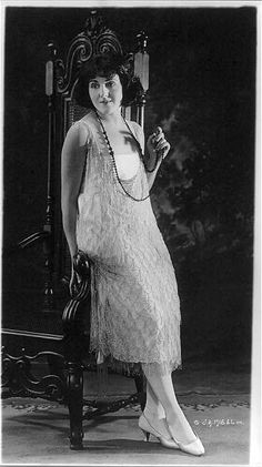 Woman modeling an evening gown, 1920