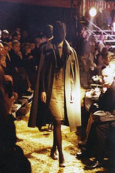 A/W 1995 - Shown in a circus tent in the Bois de Boulogne in Paris. Model faces were covered with a black muslin veil.