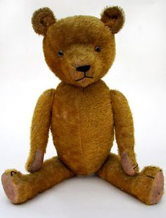 http://www.zandkantiques.com/antiques/th-early_Jointed_Teddy_Bear_large_L1.jpg