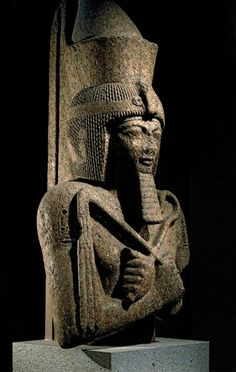 Upper part of a red granite colossal statue of Ramesses II. 19th dynasty, 1280…