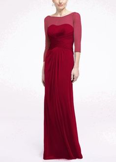 Your bridesmaids will radiate with pure elegance in thisbeautiful long mesh dress!  Long sleeve bodicewith illusion sleeves and neckline features figure flattering pleated waist.  Long soft mesh skirt flows comfortably.  Fully lined. Back zip. Imported polyester. Dry clean only.  To protect your dress, try our Non Woven Garment Bag.