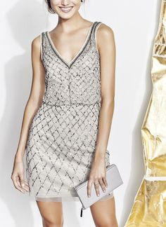Glittering beads and sequins bring Art Deco–style to this swingy cocktail dress defined with a face-framing V-neck that will make the perfect statement on New Year's Eve.