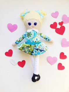 Suzy's friend Olive is wearing a blue and green long sleeve dress with white tights and black Mary Janes. She is wearing her hair in high pigtails with blue bows. Olive is pictured with blonde hair, blue eyes and fair skin.All dolls have customizable hair, eye and skin colors. Just choose your doll from the drop down menu.All dolls are about 14.5 inches tall and are made from wool felt, wool yarn and cotton fabrics.If you want to order this doll with glasses, jus...