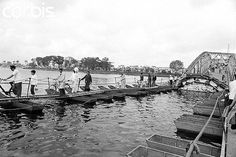 https://flic.kr/p/6F31iE | BE020374 | 22 Mar 1968, Perfume River, Hue, South Vietnam --- Pedestrians make their way up the existing span of the Bach Ho Bridge after carefully crossing the makeshift center span. The bridge near Hue, South Vietnam, had been partially destroyed during the Tet Offensive of the Vietnam War. --- Image by © Bettmann/CORBIS