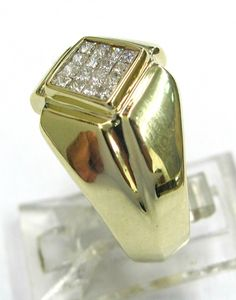 Ladies 14kt yellow gold diamond estate ring. Ring contains 16 invisible set princess cut diamonds weighing a total of approximately .33ct.