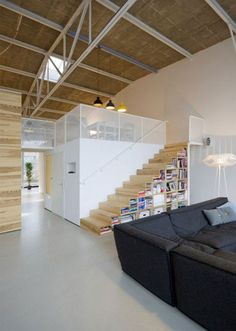 I like the way the stairs is used as bookcase.