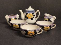 This is a great vintage child's tea set made in Japan.