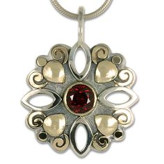 This custom variation on our Devi pendant was made using a customer's own garnet. It's a gorgeous compliment to this piece! Together Fashion, Diamond Eyes, Custom Wedding Rings, Snake Ring, Custom Jewelry Design, Claddagh, Jewelry Companies, Precious Metals, Belt Buckles