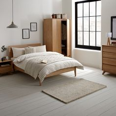 JL Stride bedroom - bed (£400) + bedside cabinet / lamp table (£150 x 2) + chest of drawers (£375) = £1075 (plus ikea wardrobe)