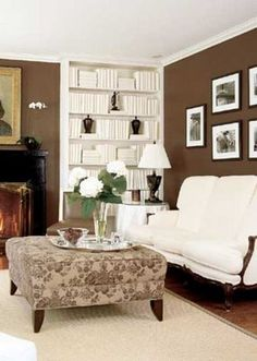 Chocolate Brown Walls And White Accents Set A Sophisticated Tone In The Living Room Wall Color Was Plucked From Ottoman Fabric