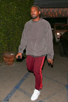 Missing Kim? Kanye West appeared in glum spirits as he left dinner with pals in LA on Monday night | KanYe