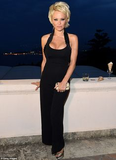 Pamela Anderson shows she's still got it in a cleavage-baring black gown at the Taormina Film Festival http://dailym.ai/1slEx58
