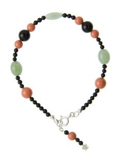 Black Onyx, Swarovski Coral Pearls and Green Aventurine Ovals are combined in this colorful bracelet from the Elegant Essentials Collection by Lee Buchanan Jewelry. The size, shape and color of the beads contribute to the style of this artisan-designed bracelet. The bracelet features our signature charm with all three types of beads included. Add a special touch to many outfits in your wardrobe with this designer piece!
