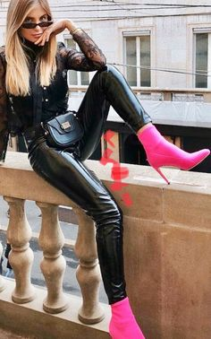 Shiny black leather leggings and hot pink heels
