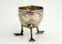 """SILVER PASSOVER EGG HOLDER. Germany c.1900. On three feet. Inscribed with former owner's name Joseph. Marked 800. 2""""tall."""