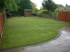 I like this style of patio meets grass - ideal for our garden