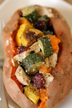 PALEO AND ZONE BASICS: 5-Minute Dinner: Stuffed Sweet Potato  Baked sweet potato, sautéed squash, zucchini, red onions, garlic, and yellow bell peppers, seasoning butter/olive oil shredded rotisserie chicken scoops of baked sweet potato. Full sweet potato with sautéed stuff and baked again till heated. Yum!