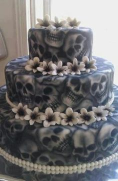 Tiered skull cake. #flowers #skulls #cake #InkedMagazine #Inked #food #decor #baking #art