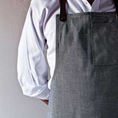 one-of-a-kind aprons are made of 12 oz. indigo selvage W401 denim from Cone Denim Mills in North Carolina with hidden selvage throughout. They are designed with hand-dyed leather riveted straps, an upper pocket with upper opening, a lap pocket, and a hammer loop.