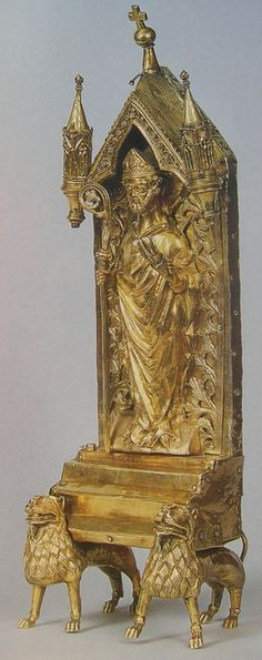 This is a reliquary for the tooth of St. Nicholas, which the Saint is holding. (Prague, ca. 1300)