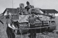 Photographed in the early summer of 1943, the crew of this Tiger from Leibstandarte Division is cleaning the barrel of the gun.