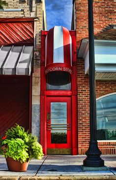Little Popcorn Shop in Downtown Wheaton - A favorite local Wheaton, Illinois landmark, the Little Popcorn Shop and Store is perhaps one of the narrowest stores in the Chicago area measuring 49 inches wide by 60 feet long. Wheaton Illinois, Popcorn Shop, Portal, Chicago Travel, Chicago Area, Alleyway, My Kind Of Town, Summer Bucket Lists, Children's Place