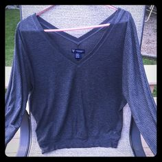 Super cute sparkly gray American Eagle Shirt! 💥🌟 This is an American Eagle long sleeve dark gray shirt with silver stripes! This shirt comes to about my hips and would be perfect for those summer nights when a cute and comfy long sleeve is needed! Only worn a few times and still in perfect condition! Very flattering! ✨🔥💫💥 American Eagle Outfitters Tops Tees - Long Sleeve