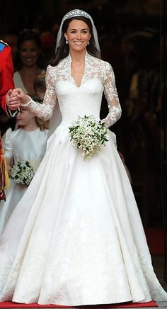 Kate  Middleton's wedding gown designed by Sarah Burton, creative director of Alexander McQueen.  The ivory and white  silk gazar wedding dress with V-neck lace bodice is a delightful combination of traditional and modern elements.