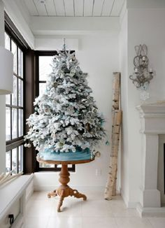 Beautiful for a 2nd tree  or small apartment Small White Christmas Tree Decorating Ideas