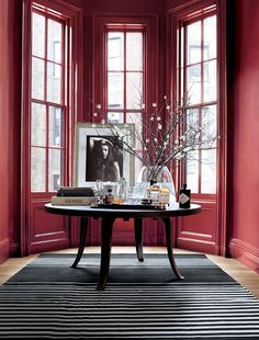 Ralph Lauren Paint Townhouse red grounds a bay window in sophisticated downtown style. From the new Greenwich Village palette.