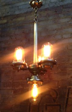 The Nautilus Chandelier. Made by Omega Lighting Design. Created out of old, solid cast brass shipyard lights.