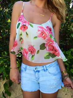 Love this top ... Would look much better paired with a pink maxi skirt instead of cut-off shorts.