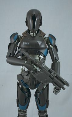 """Front detail of the black """"Synth"""" robot cop, painted for Hollywood Collectibles Group"""". - Paint by Gordon Oberman"""