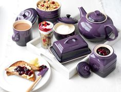 Add some colour to the breakfast table with our range of Le Creuset stoneware. This image features our classic teapot, butter dish, jam jar, mug and sugar bowl. All available in a range of colours.