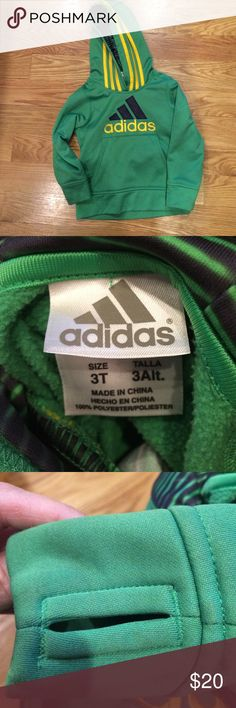 3T ADIDAS  green hoodie w front pocket Like new condition. 3T Adidas hoodie w thumb holes (pic 3) and patterned lining inside hood (pic4) Adidas Jackets & Coats