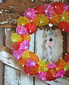 How cute would this drink umbrella wreath be for your summer party decor!? by blondiebluvintage via Flickr