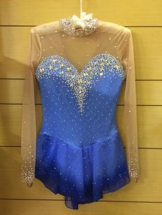 blue lycra dress, with airbrush mesh skirt. Swarovsry stones in deferent sizes and shapes. Size adult Small