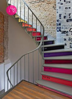 """There isn't much I don't absolutely love in this pic : first off, the colored-step stairs, obviously. What a fabulous idea, a perfect """"think outside the box"""" example, just as I like them… And then, against these vibrant pops of color, the old brick exposed walls that have been kept untouched as if they were..."""
