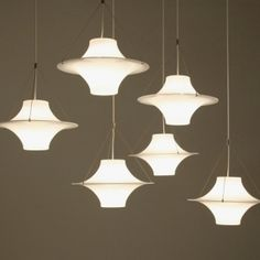 Sky Flyer lamps by Finnish designer Yki Nummi, Finland. Wonderful as a single piece and in a large combination it seems like a set of birds or ufos in the sky