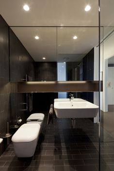 Great use of mirrors to bounce the light in this moody bathroom