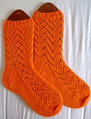Asymmetric spiralling zigzag socks in two sizes (60 stitches and 72 stitches.)