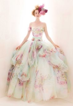 7. Floral Print Dress (price upon request): Fanciful, imaginative and uniquely artistic, this regal Atelier Aimee ball gown evokes visions of a watercolor painting. | 18 Colorful Wedding Dresses for the Non-Traditional Bride | Brit + Co