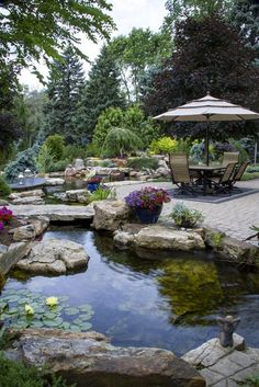 In my humble opinion, you can't have an outdoor paradise without a backyard pond. Enjoy this roundup of refreshing examples of outdoor spaces. 10 Awesome DIY Garden Pond Ideas You Can Build To Add Beauty To Your Backyard Backyard Water Feature, Large Backyard, Backyard Ponds, Garden Ponds, Koi Ponds, Garden Water, Water Gardens, Backyard Patio, Patio Pond
