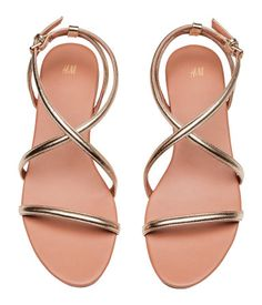 Gold-colored. Sandals with adjustable straps with metal buckle. Faux leather lining and insoles. Rubber soles.