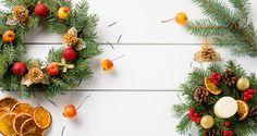 Christmas wreath on white wooden table top view by Kamil Zabłocki - Photo 130543115 / 500px