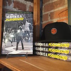 """Our newest book display for """"Heaven Is A Playground"""" which tells the story of the early American phenomenon that was urban basketball. . . #Hoops #vintageinspired #Brooklyn #NBA #BasketballBooks #NYC #SportsPublishing #Courtside #Basketball #Summer #StreetsOfNewYork"""