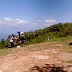 Paragliding at Kokol Hill.  Follow me at Twitter @donaldrosli or log on to my blog TRAVEL LEISURE AND GOLF IN BORNEO.  #paragliding #sports #travel #leisure #tandem #flying #kokol #kotakinabalu #Sabah #malaysia #holiday