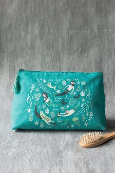 Sea Spell Large Cosmetic Bag - A large cosmetic bag made from 100% linen and with a vegan leather lining is perfect for storing your beauty essentials, accessories, toiletries and more. A tassel adds for tactile interest. Enchanting merfolk swim in a swirl of aquatic greens and blues amongst playful mercats and merdogs. Large Cosmetic Bag, To My Mother, Travel Toiletries, Merfolk, Cat Design, Beauty Essentials, Large Bags, Zipper Pouch, Travel Style