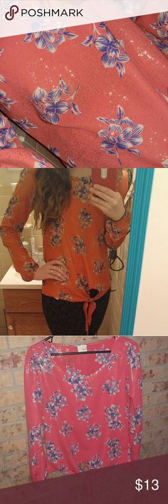 Daytrip Blouse Super cute orange daytrip blouse with navy and cream flowers throughout and a touch of gold shimmer all over the blouse. Its hard to capture the gold flakey glitter in the pics. The 1st pic you can see it best.  Sizing: Medium but fits in the shoulders like a small in my opinion.   Condition: perfect, no stains, rips, tears, no signs of wear Daytrip Tops Blouses