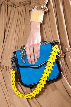Loewe // bright blue purse with black leather trim, silver chain with yellow arrow strap
